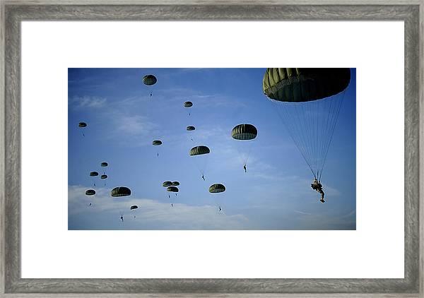 Soldiers Descend Under A Parachute Framed Print