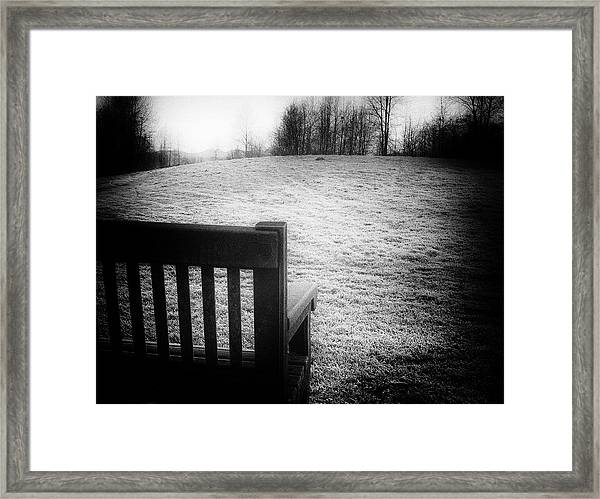 Solitary Bench In Winter Framed Print