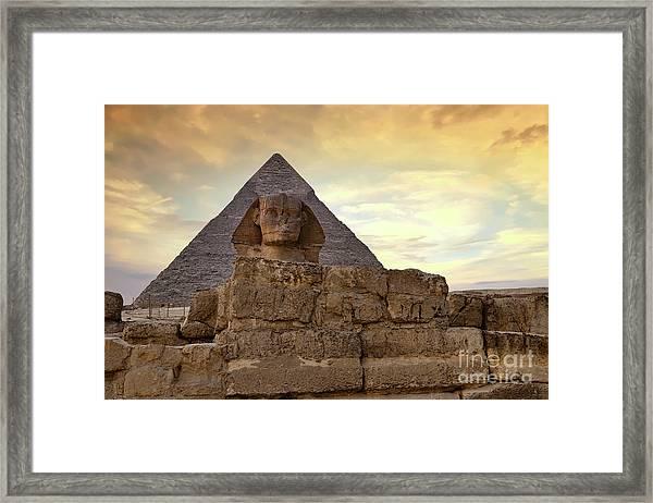 Sphinx And Pyramid At Dusk Framed Print