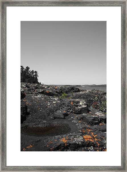 Framed Print featuring the photograph Spotted Rocks by Dylan Punke