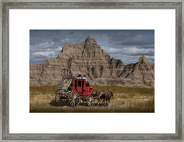 Stage Coach In The Badlands Framed Print