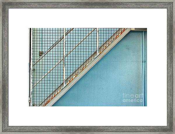 Stairs On Blue Wall Framed Print