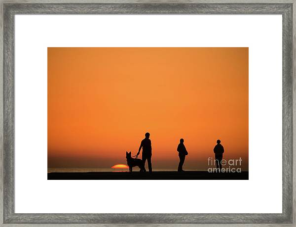 Standing At Sunset Framed Print