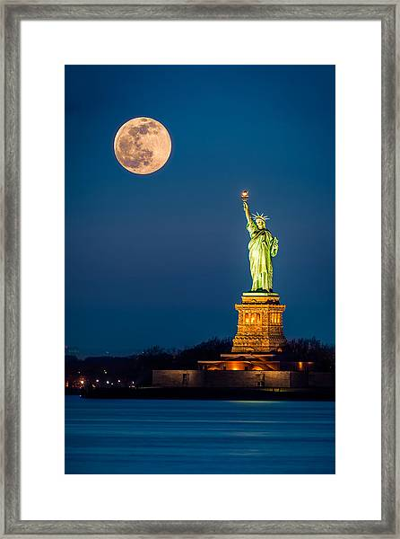Statue Of Liberty And A Rising Supermoon In New York City Framed Print
