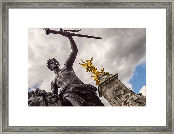 Statues In Front Of Buckingham Palace Framed Print