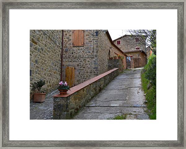 Steep Street In Montalcino Italy Framed Print