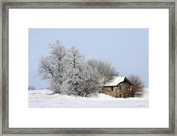 Stone House In Winter Framed Print