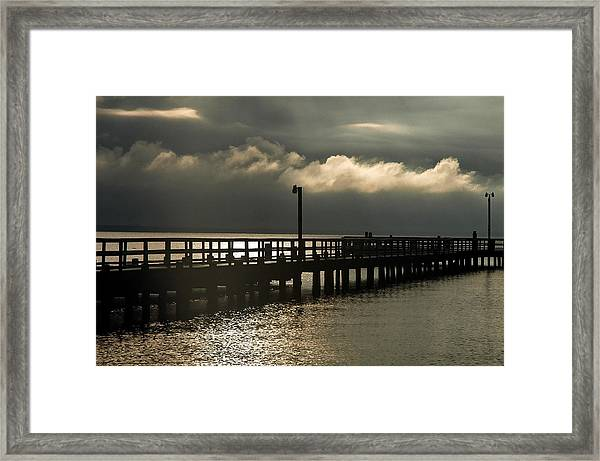 Storms Brewin' Framed Print