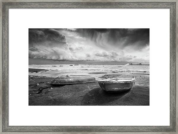 Stormy Sky Sea And Boats Framed Print