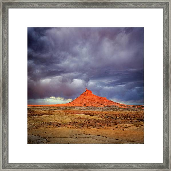 Stormy Sunset Above Factory Butte. Framed Print