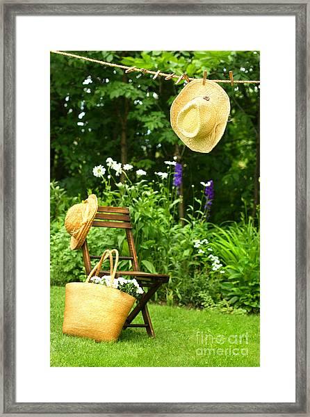 Straw Hat Hanging On Clothesline Framed Print