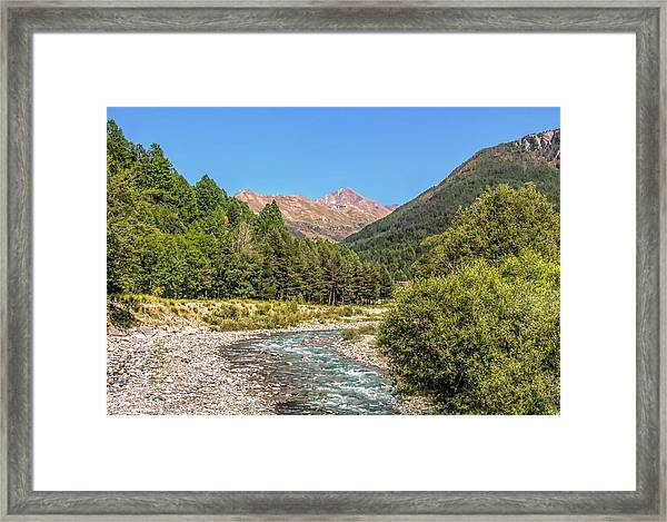 Streaming Through The Alps Framed Print
