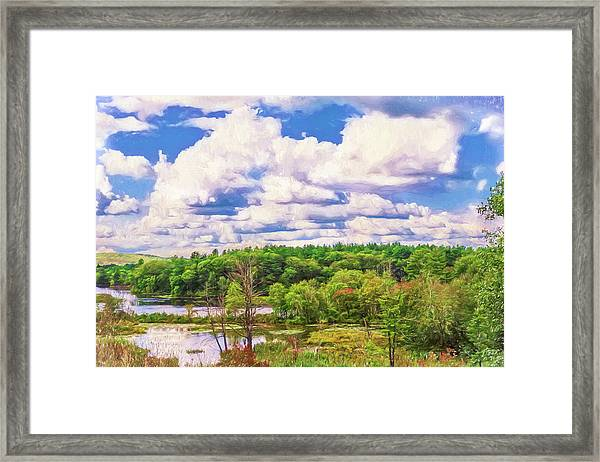 Striking Clouds Above Small Water Inlet And Green Trees Framed Print