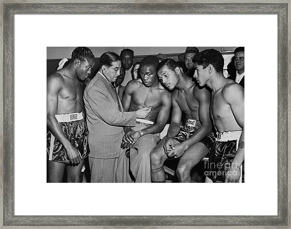 Sugar Ray Robinson And Others Go Through A Pre-fight Checkup. 1948 Framed Print by Anthony Calvacca
