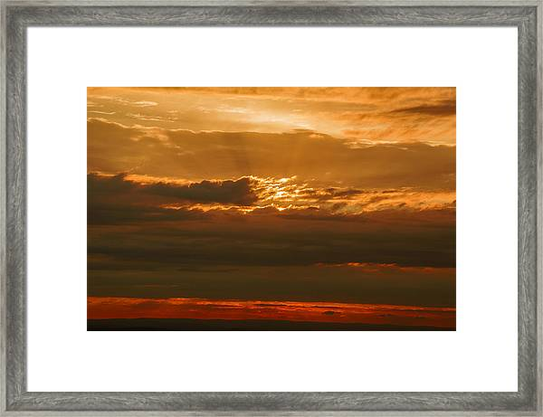 Sun Behind Dark Clouds In Vogelsberg Framed Print
