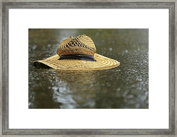 Sun Hat In The Rain Framed Print
