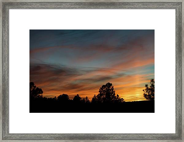 Framed Print featuring the photograph Sun Pillar Sunset by Jason Coward