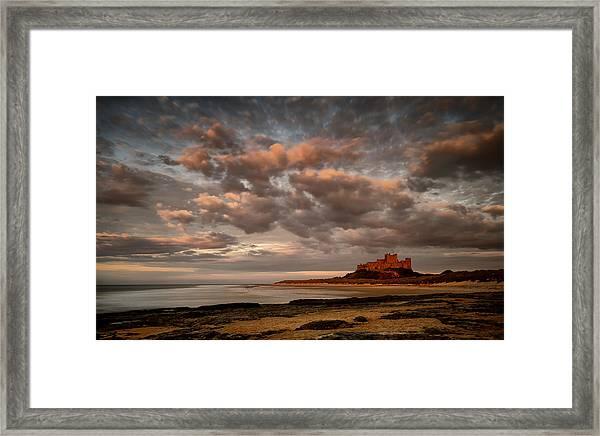 Sun Setting On Bamburgh Castle Framed Print