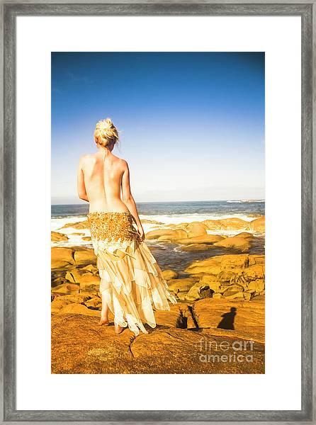 Sunbathing By The Sea Framed Print
