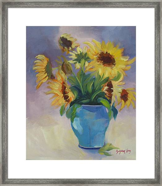 Sunflowers In Blue Vase Framed Print