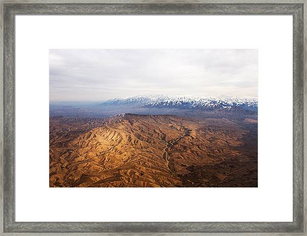 Sunlight And Snow-capped Peaks Framed Print