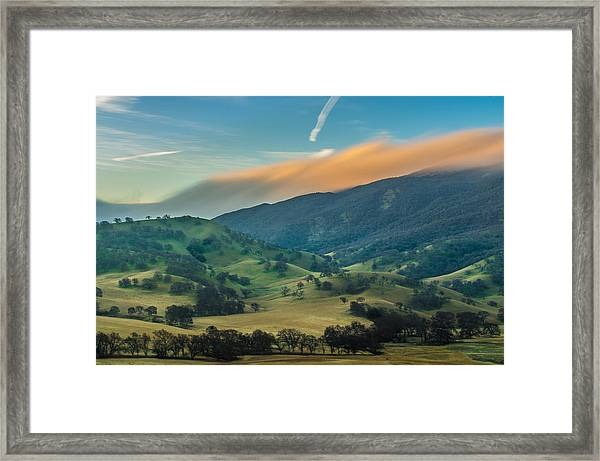 Sunlit Clouds On A Ridge Framed Print
