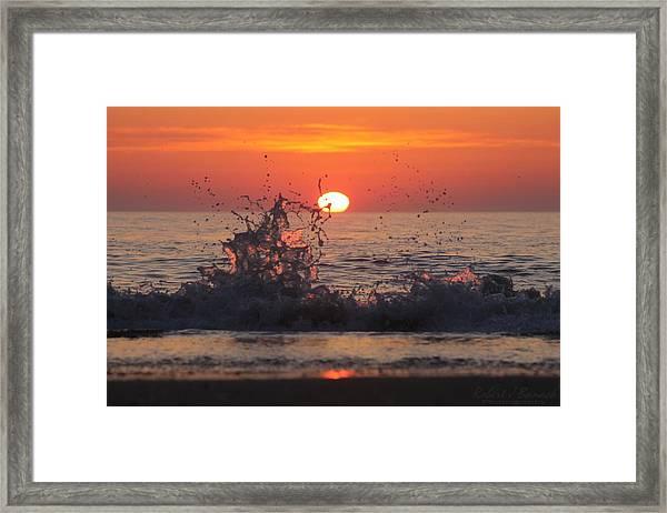 Sunrise And Splashes Framed Print
