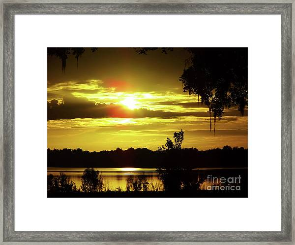 Sunrise At The Lake Framed Print