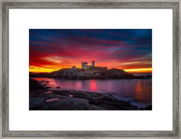 Sunrise Over Nubble Light Framed Print