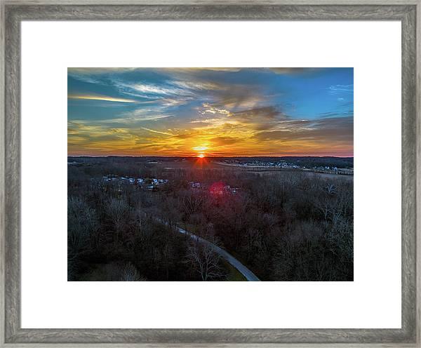 Sunrise Over The Woods Framed Print