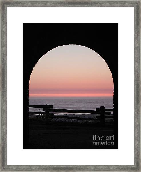 Sunset Arch With Fog Bank Framed Print