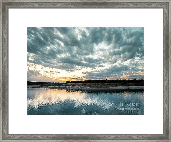 Sunset Behind Small Hill With Storm Clouds In The Sky Framed Print