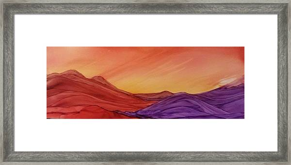 Sunset On Red And Purple Hills Framed Print