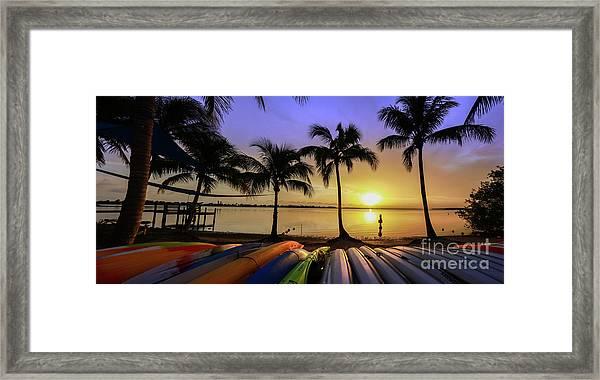 Sunset Over The Kayaks Framed Print