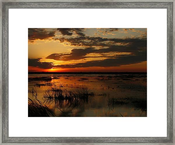 Sunset Over The Marsh Framed Print
