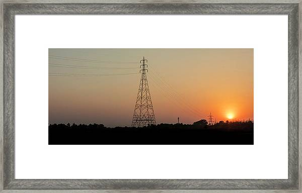 Framed Print featuring the photograph Sunset Pylons by Chris Cousins