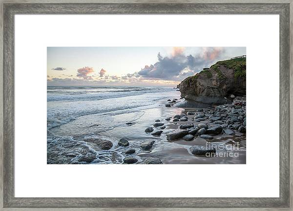 Sunset View In The Distance With Large Rocks On The Beach Framed Print