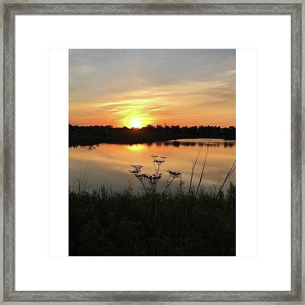 Amber Sunset By The Lake Framed Print