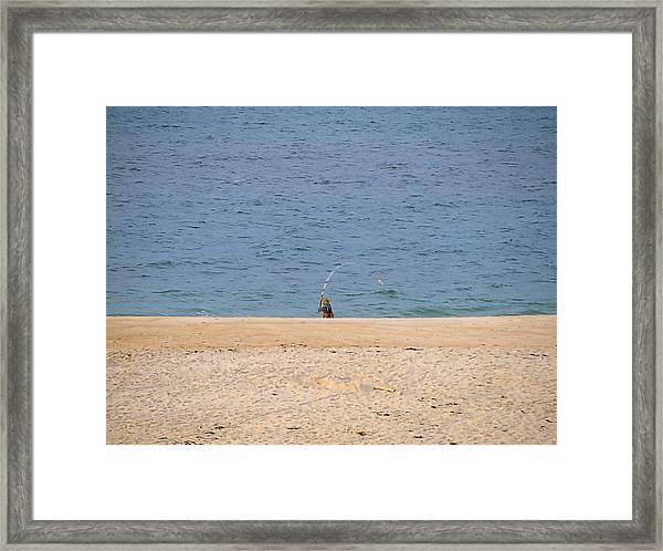 Surf Caster Framed Print