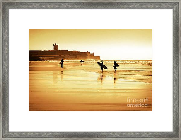 Surfers Silhouettes Framed Print
