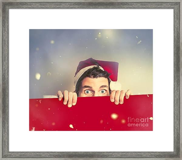Surprised Santa Elf Holding Red Christmas Board Framed Print