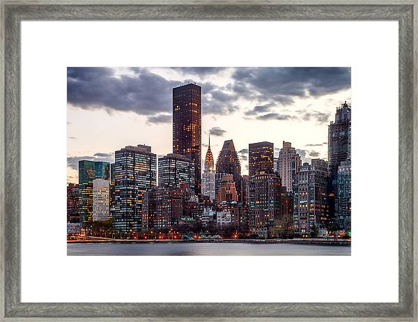 Surrounded By The City Framed Print