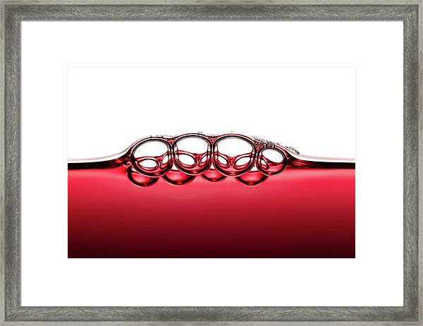 Symmetrical Red Wine Bubbles Framed Print