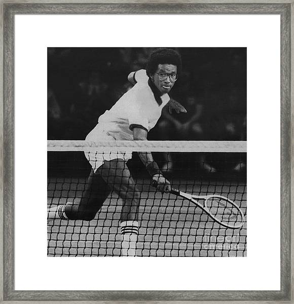 Tennis Great, Arthur Ashe, Returns The Ball At The Atp Worls Tour Finals In 1979. Framed Print by Bob Olen