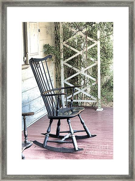 The Blue Rocking Chair  Framed Print