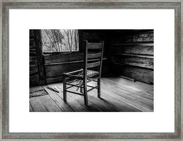The Broken Chair Framed Print