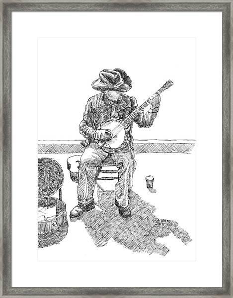 The Cold Banjo Player Framed Print
