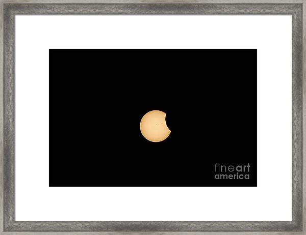 The Eclipse Begins Framed Print
