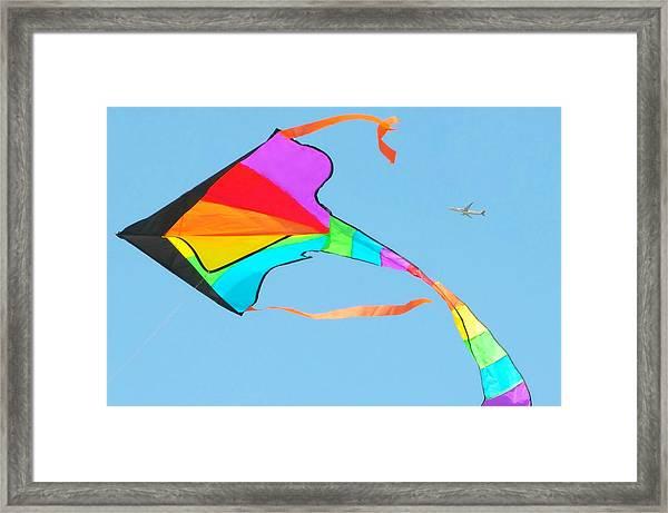 Flight And The Kite Framed Print