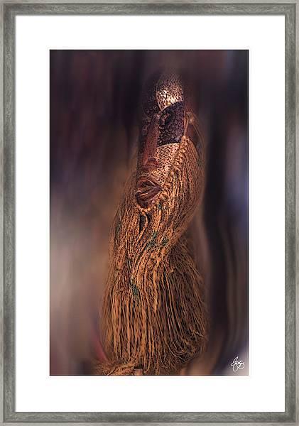 The Floating Mask Framed Print